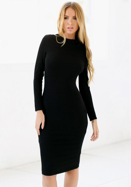 Model looking classy with black mock neck midi dress