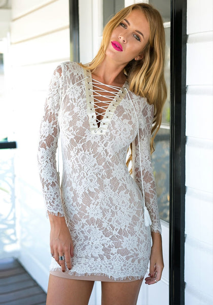 Model looking radiant in white lace-up sheath lace dress