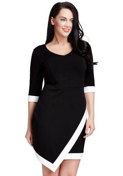 Model poses in black asymmetric wrap bodycon dress with head turned to side