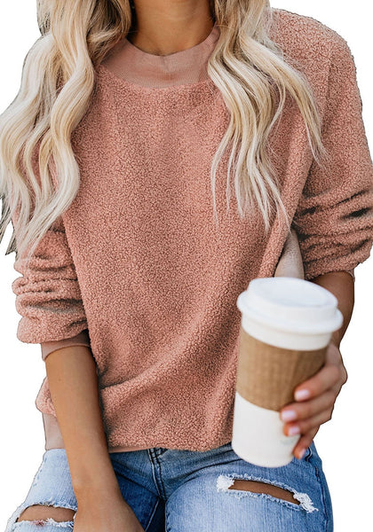 Model poses wearing apricot crewneck terry cashmere pullover sweatshirt