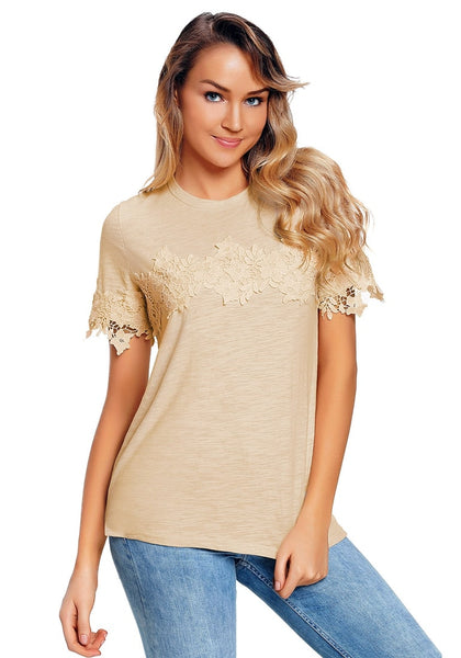 Model poses wearing apricot floral crochet short sleeves blouse