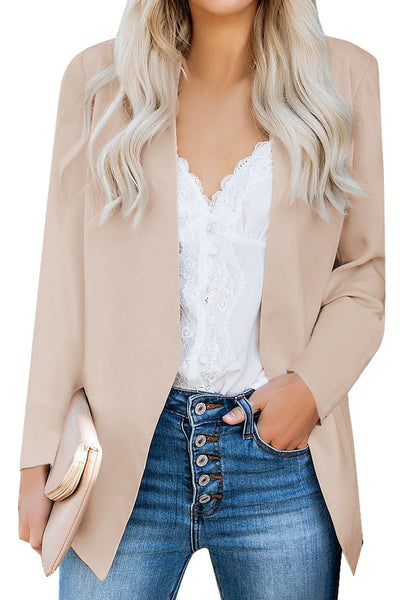 Model poses wearing apricot open-front side pockets blazer