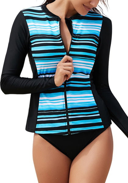 Model poses wearing aqua blue striped zip-front long sleeves rash guard