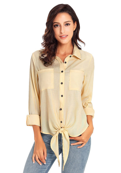 Model poses wearing beige 34 sleeves tie-front button-up blouse