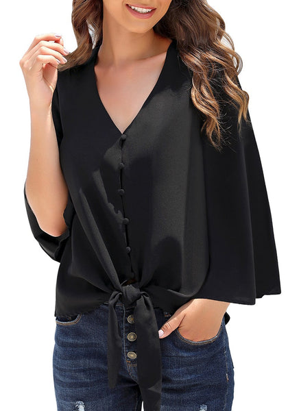 Model poses wearing black V-neckline button loop loose top