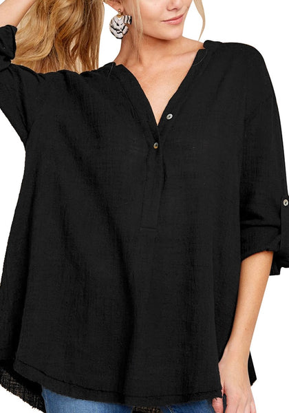 Model poses wearing black V-neckline roll-tab sleeves loose tunic top