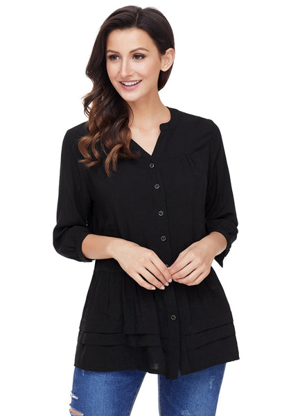 Model poses wearing black button-front puffed sleeves tunic