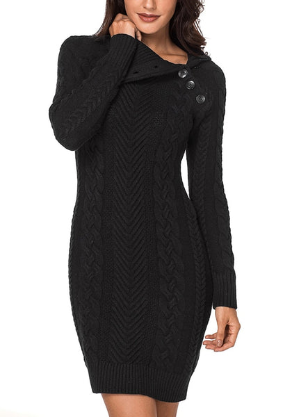 Model poses wearing black cable knit split cowl neck sweater dress