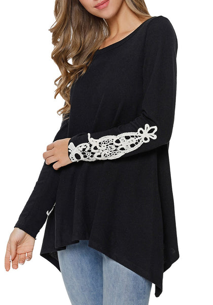 Model poses wearing black crochet applique long sleeves asymmetrical top