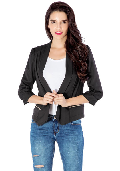 Model poses wearing black crop sleeves lapel blazer