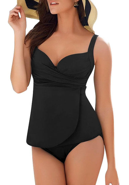 Model poses wearing black cross wrap ruched sweetheart tankini set