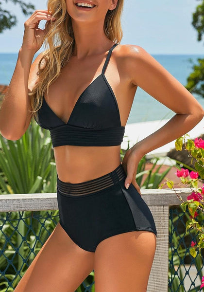 Model poses wearing black elastic panel high-waist swim bottom with her triangle top