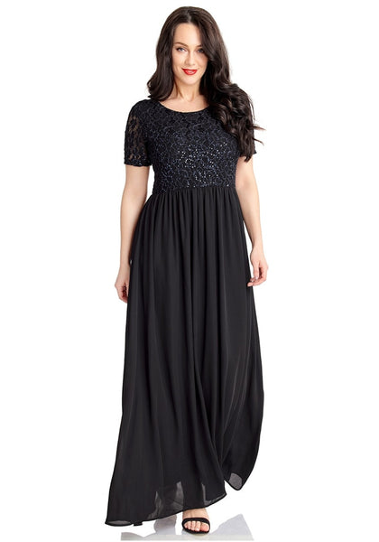 Model poses wearing black floral hollow lace sequin-embellished maxi dress