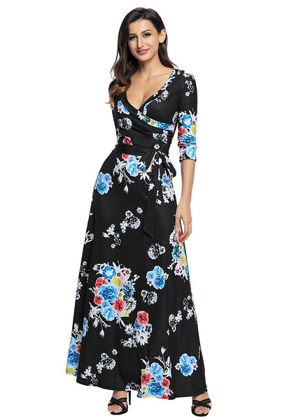 Model poses wearing black floral print boho long faux wrap dress