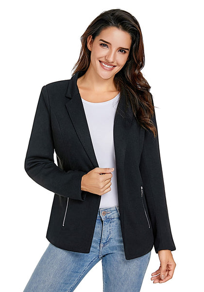 Model poses wearing black notched lapel side zip blazer