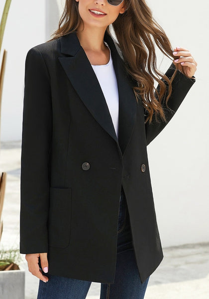 Model poses wearing black oversized pockets double-breasted blazer
