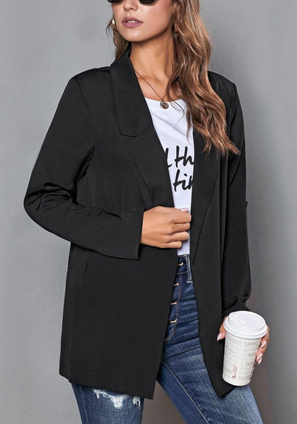 Model poses wearing black roll-up sleeves side-slit notch lapel blazer