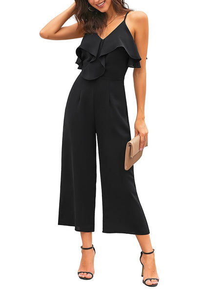 Model poses wearing black ruffled spaghetti-strap surplice jumpsuit