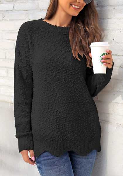 Model poses wearing black scalloped hem fleece knit pullover sweater