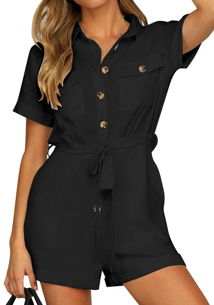 Model poses wearing black short sleeves button-down belted rompers