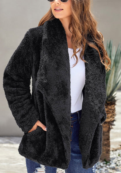 Model poses wearing black side-pockets lapel fleece coat