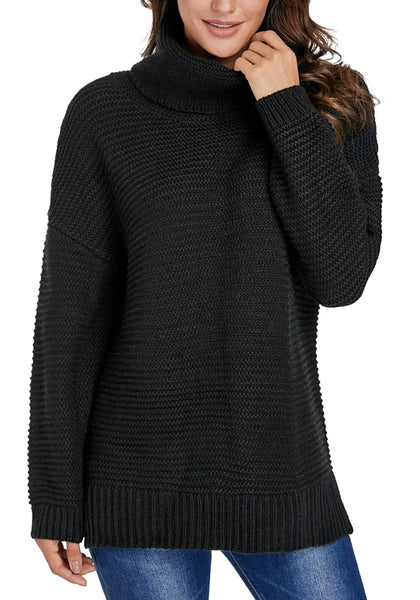 Model poses wearing black side slit turtleneck textured knit sweater