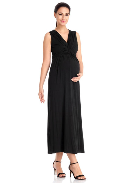 Model poses wearing black sleeveless A-line long maternity dress