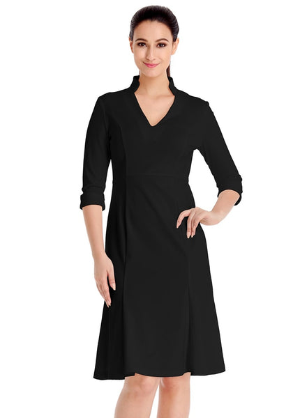 Model poses wearing black stand collar crop sleeves dress