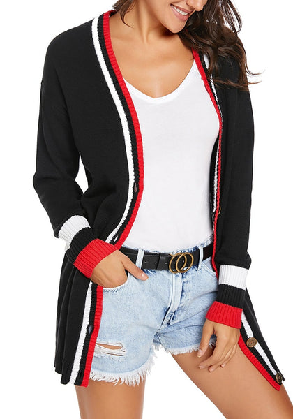 Model poses wearing black striped trim button-up knit cardigan