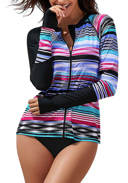 Model poses wearing black striped zip-front long sleeves rash guard