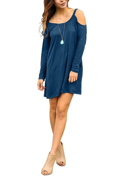 Model poses wearing blue cold-shoulder tunic dress