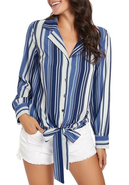 Model poses wearing blue long sleeves tie front striped button-up top