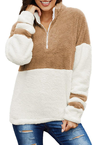 Model poses wearing brown colorblock half-zip fuzzy fleece pullover
