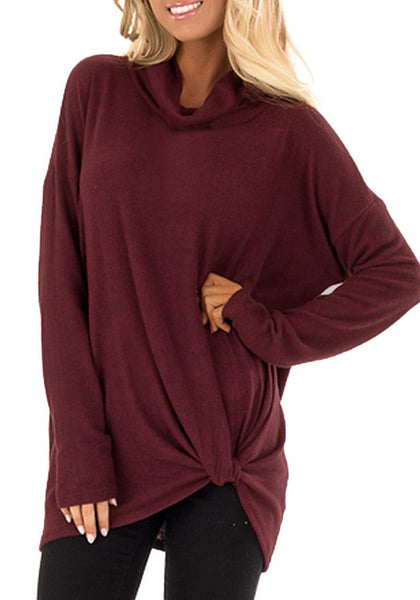 Model poses wearing burgundy cowl neck side twist knot tunic top