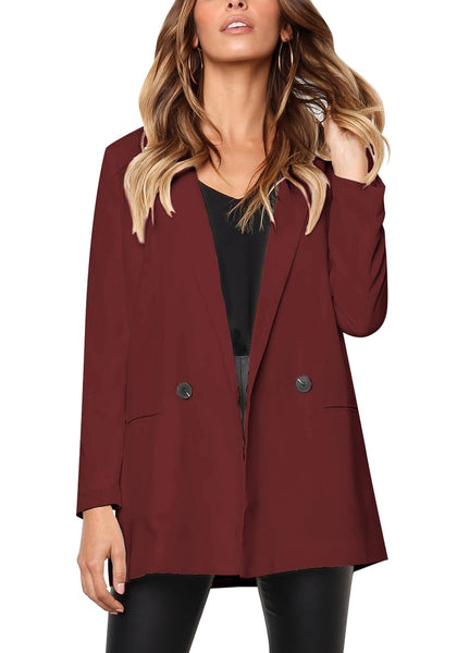 Model poses wearing burgundy mock-pocket double-breasted lapel blazer