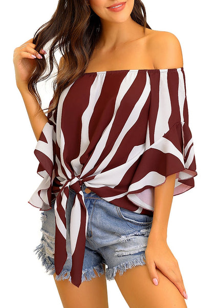 Model poses wearing burgundy striped flare sleeves tie-front off-shoulder top