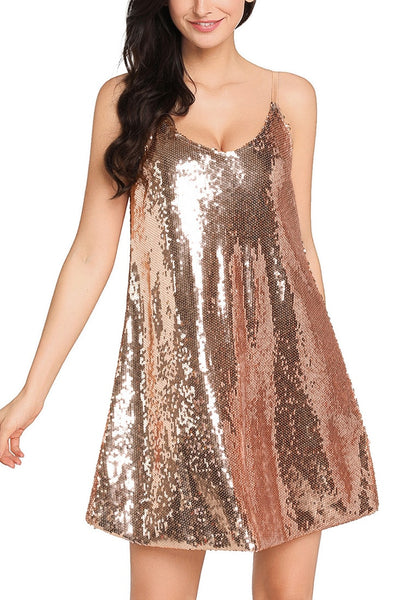 Model poses wearing champagne sequins slip dress
