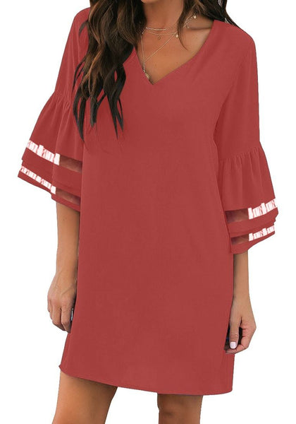 Model poses wearing dark coral pink 34 mesh sleeves V-neck mini shift dress