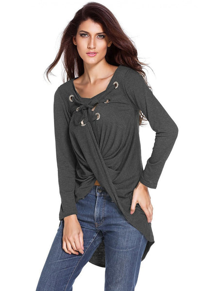 Model poses wearing dark grey asymmetrical lace-up blouse