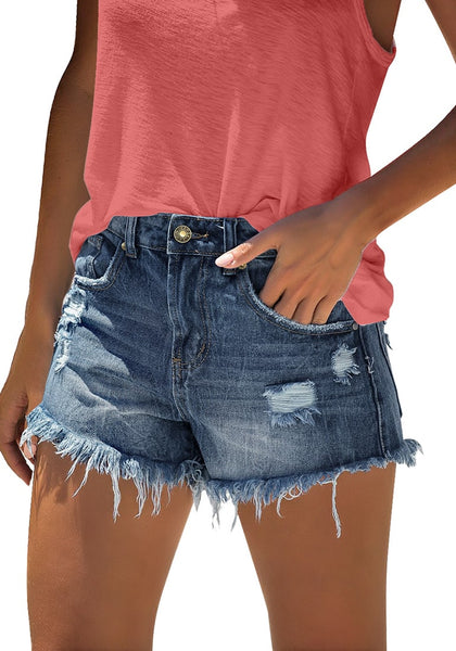 Model poses wearing deep blue frayed raw hem ripped denim shorts