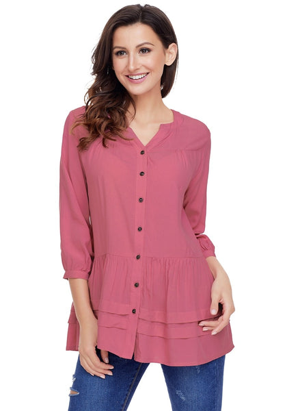 Model poses wearing deep blush button-front puffed sleeves tunic