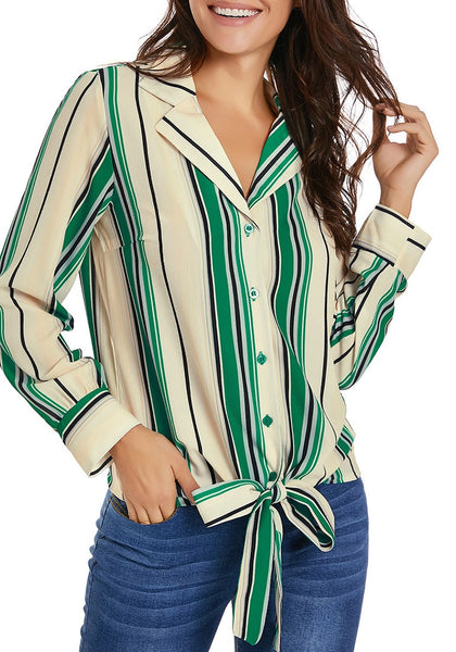 Model poses wearing green long sleeves tie front striped button-up top