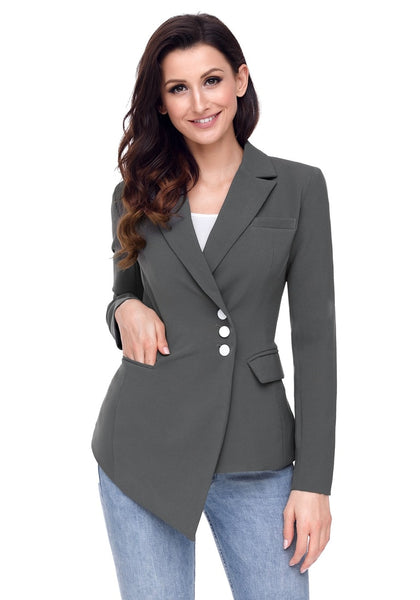 Model poses wearing grey asymmetrical side buttons blazer