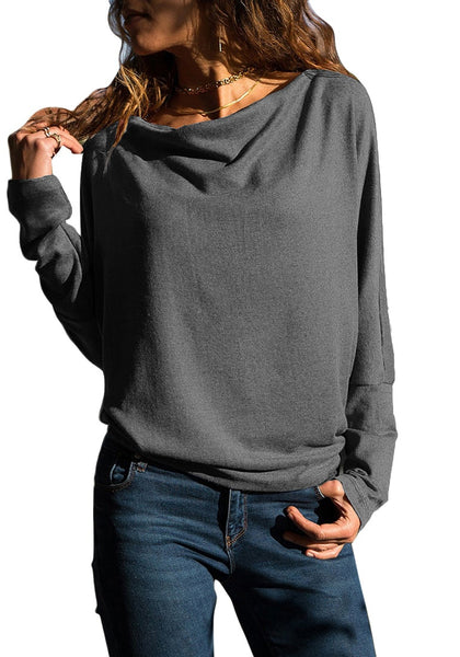Model poses wearing grey boat neck long sleeves pullover top