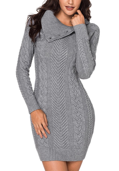 Model poses wearing grey cable knit split cowl neck sweater dress