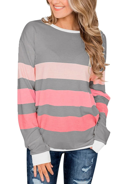Model poses wearing grey color block striped pullover sweatshirt