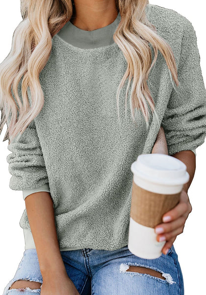 Model poses wearing grey crewneck terry cashmere pullover sweatshirt