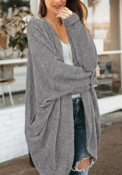 Model poses wearing grey curved hem long chenille knit cardigan