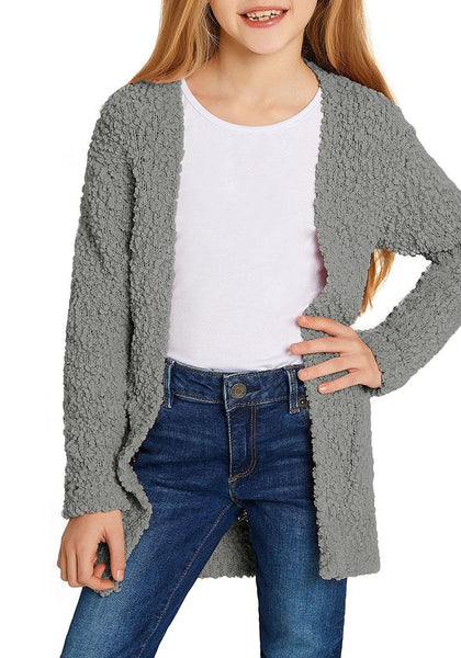 Model poses wearing grey fuzzy fleece open-front girls' cardigan