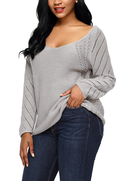 Model poses wearing grey hollow out cotton sweater